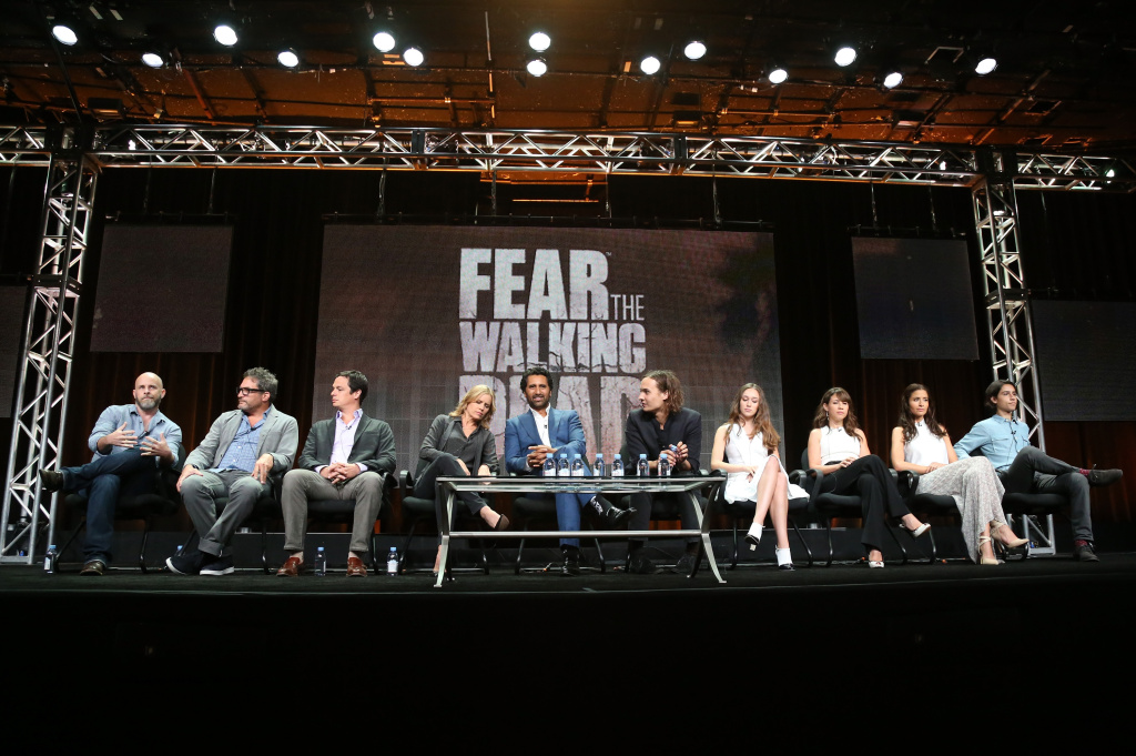 (L-R) Executive producer/writer Dave Erickson, executive producer/director Adam Davidson, executive producer Dave Alpert, and actors Kim Dickens, Cliff Curtis, Frank Dillane, Alycia Debnam-Carey, Elizabeth Rodriguez, Mercedes Mason, and Lorenzo James Henrie speak onstage during the 'Fear the Walking Dead' panel discussion at the AMC/IFC Networks portion of the 2015 Summer TCA Tour at The Beverly Hilton Hotel on July 31, 2015 in Beverly Hills.