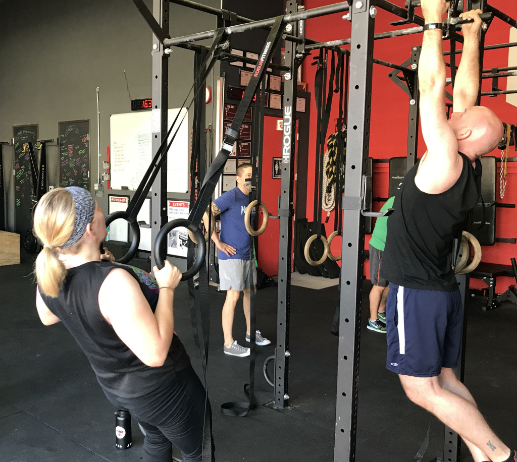 """Andrew Deutch guides people through the """"Mothership"""" work out, which is based on the film """"Independence Day."""""""