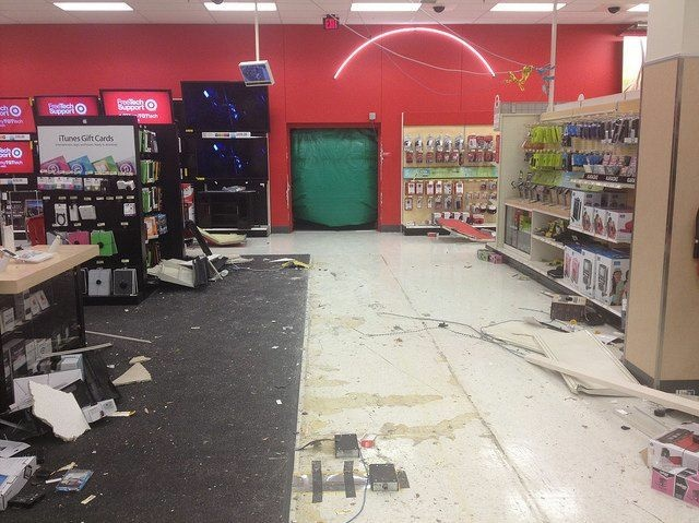A BMW Sits In Debris After It Crashed Through A Target Store.