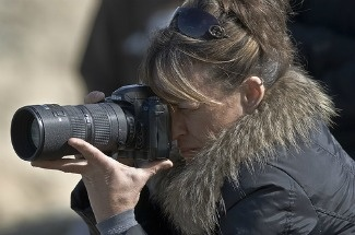 A female photographer in Morro Bay, California.
