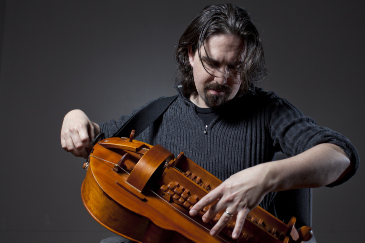 Composer Bear McCreary plays his hurdy-gurdy at the KPCC studios on Monday, Jan. 5.