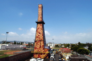 A 165-foot-tall oil well tower (C) decorated with flower designs in 2000 by children suffering from cancer and other serious diseases stands at Beverly Hills High School May 6, 2003 in Beverly Hills, California.