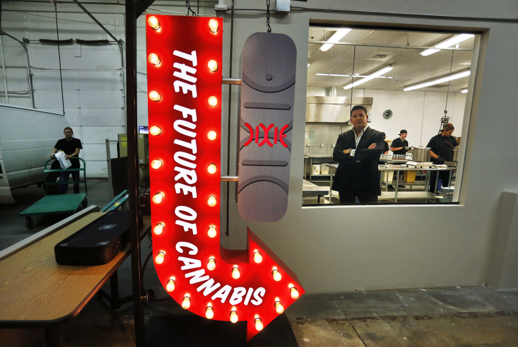 In this Sept. 25, 2014 photo, Tripp Keber, head of Denver-based Dixie Elixirs & Edibles, which makes pot-infused drinks, foods and other items, stands inside one of his edibles production kitchens at his manufacturing facility in Denver.