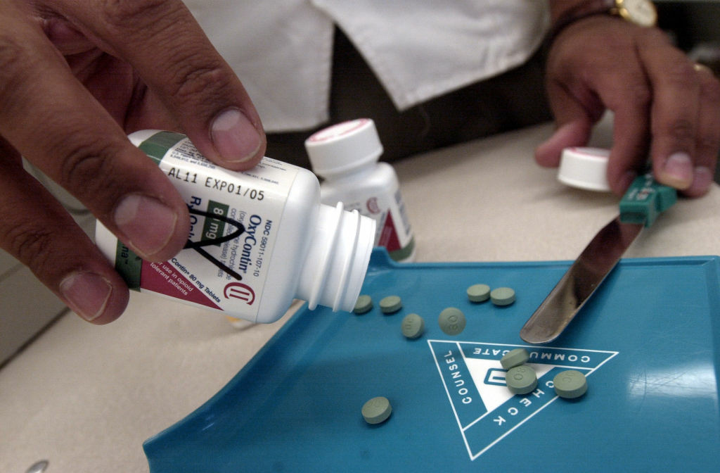 The prescription medicine OxyContin is displayed August 21, 2001 at a Walgreens drugstore in Brookline, MA. The powerful painkiller, manufactured to relieve the pain of seriously ill people, is being used by some addicts to achieve a high similar to a heroin rush.