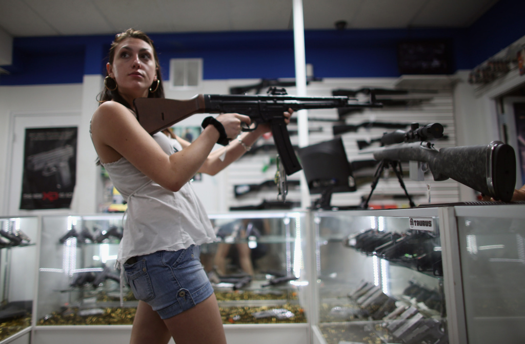 Cristiana Verro browses for guns at the National Armory gun store on April 11, 2013 in Pompano Beach, Florida.