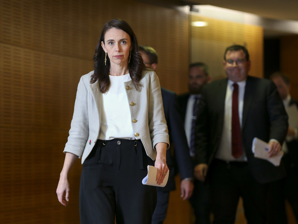 New Zealand Prime Minister Jacinda Ardern arrives for a press conference Friday in Wellington. A new coronavirus outbreak has grown to 30 cases, and Ardern predicts of the cluster,