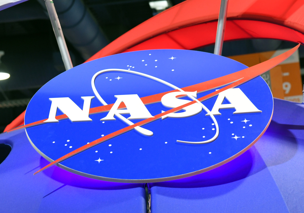 The NASA logo is displayed at the agency's booth during CES 2018 at the Las Vegas Convention Center on January 11, 2018 in Las Vegas, Nevada