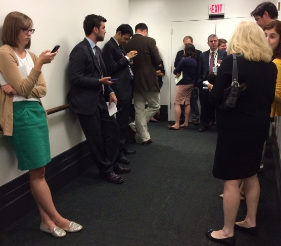 With the vote on a border funding bill up in the air, reporters wait for news outside a House GOP meeting.
