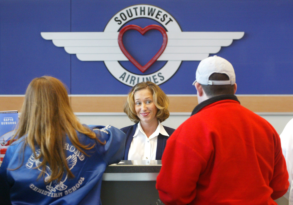 Southwest Airlines customer service agent Tricia Arrigo assists travelers at the Southwest Airlines ticket counter.