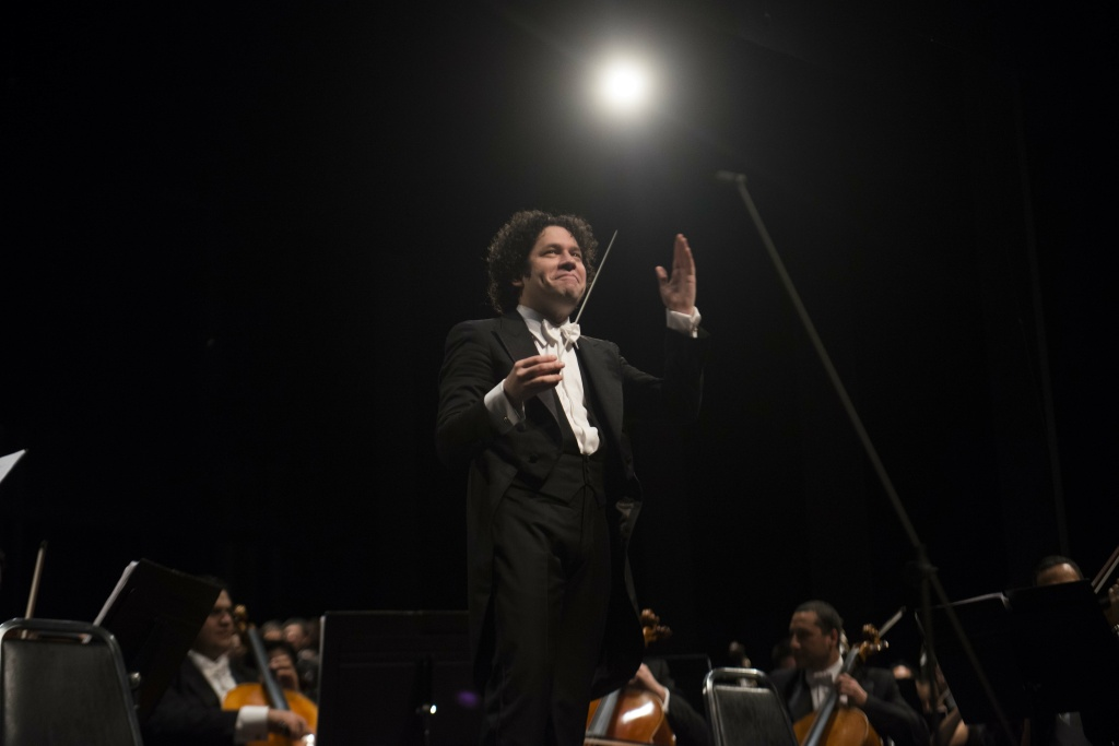 Venezuelan maestro Gustavo Dudamel conducts the Simon Bolivar National Youth Orchestra during a concert at Berkeley University in San Francisco, California, on November 30, 2012 during a US tour.