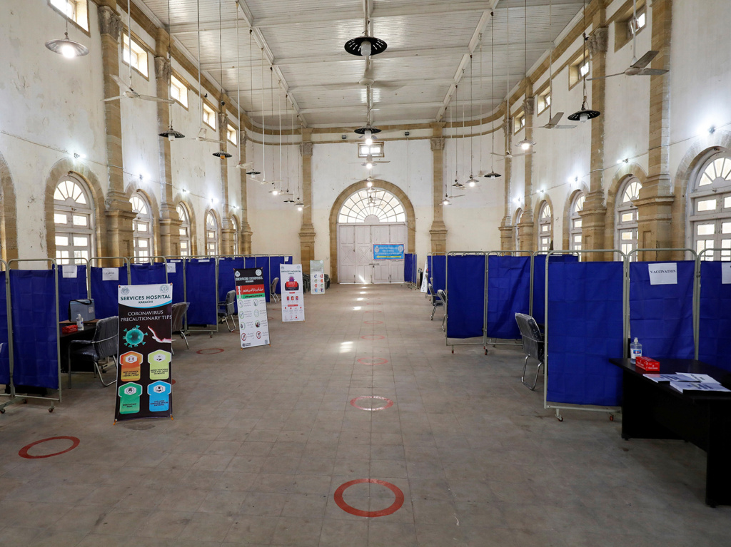 The Khaliq Dina Hall and Library building in Karachi, Pakistan, has been converted into a COVID-19 vaccination center.