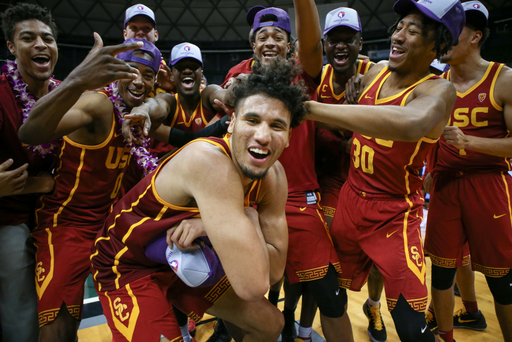 Bennie Boatwright #25 (c) of the USC Trojans poses with his teammates at the Stan Sheriff Center on December 25, 2017 in Honolulu, Hawaii. Boatwright is facing an investigation from the DOJ for alleged violation of NCAA rules.