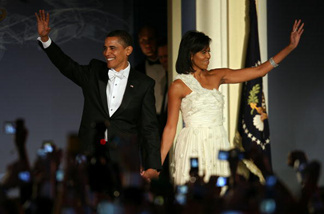 U.S President Barack Obama and his wife First Lady Michelle Obama arrive on stage during MTV & ServiceNation: Live From The Youth Inaugural Ball at the Hilton Washington on January 20, 2009 in Washington, DC.
