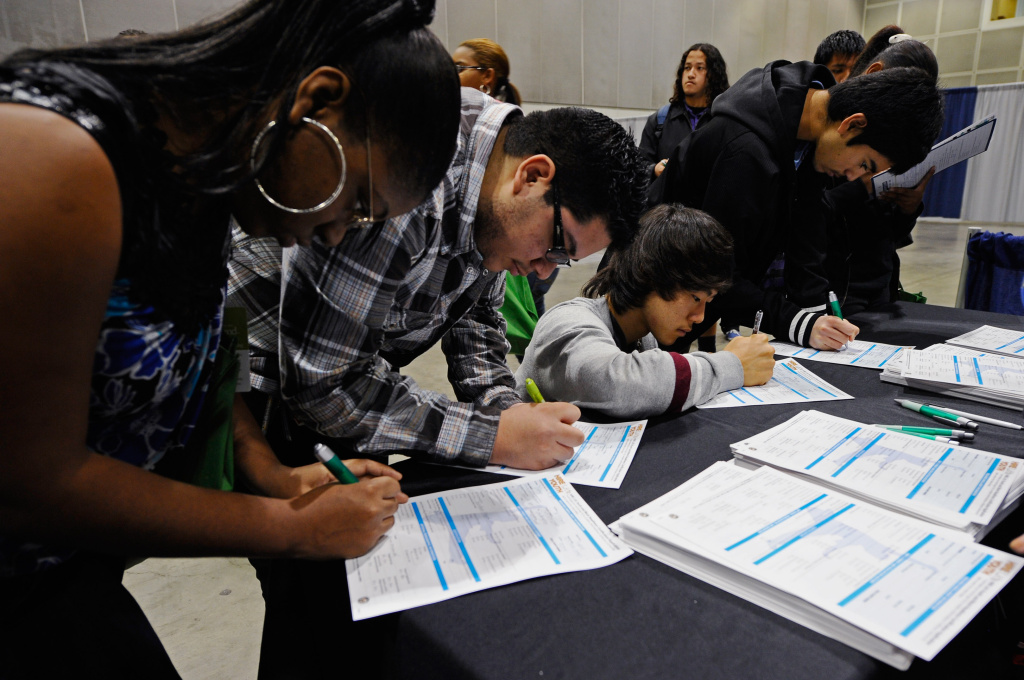 Students fill out applications for youth programs at Hire LA's Youth booth for a chance of finding a job as they attend Cash for College, a college and career convention, at the Los Angeles Convention Center on December 8, 2010 in Los Angeles, California.