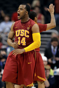 Donte Smith #14 of the USC Trojans reacts after making a basket in the first half against the Arizona Wildcats in the semifinals of the 2011 Pacific Life Pac-10 Men's Basketball Tournament at Staples Center on March 11, 2011 in Los Angeles.