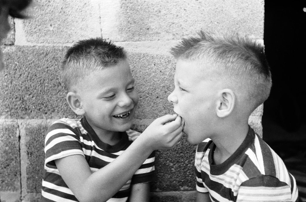 circa 1955: Bobby, whose two front teeth dropped out recently, gives his twin brother Jerry some assistance with his loose front teeth, due to drop out shortly. A new survey shows kids this year are getting an average of $3.70 per lost tooth, a 23 percent jump over last year's rate of $3 a tooth.