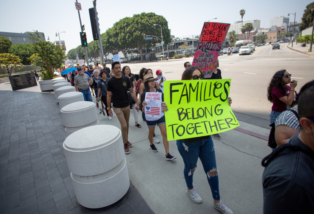 Protesters circle the Immigration and Customs Enforcement processing center in protest to the Trump administrations family separations related to the zero-tolerance policy along the border, in Los Angeles, California, June 21, 2018.