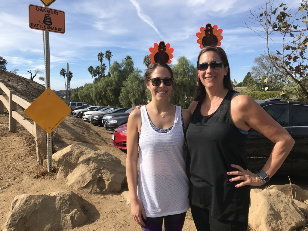Robyn Rubin (left) and Debby Alberts during a Thanksgiving day hike at the Runyon hiking trails. Temperatures set records in Southern California for the warmest Thanksgiving holiday ever recorded.