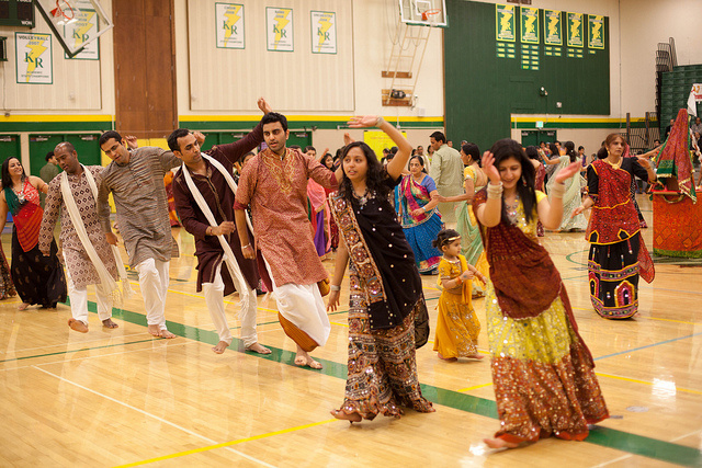 A group participates in garba, a folk dance that originated in India.