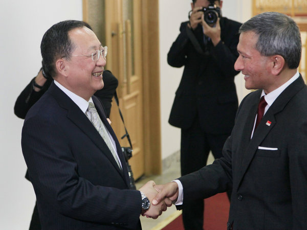 North Korean Foreign Minister Ri Yong Ho (left) shakes hands with Singapore Foreign Minister Vivian Balakrishnan in Pyongyang on June 7.