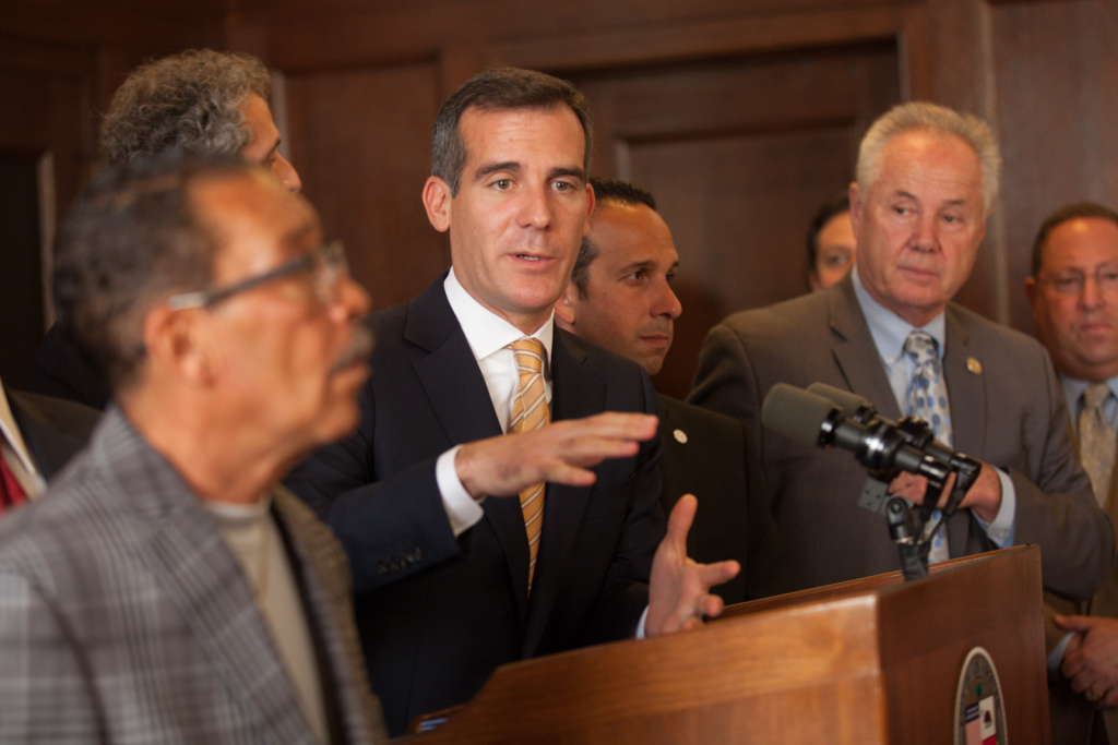 Mayor Eric Garcetti and City Council President Herb Wesson (foreground) announced a deal reached with the DWP union on a new labor contract.