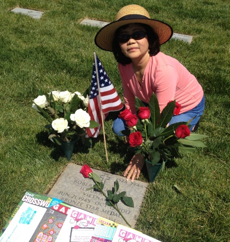 Apple Jacobs at her husband Bob's grave at the Riverside National Cemetery in early May. Bob Jacobs, 67, a Vietnam veteran, died in October 2012. She says if he were interred in Orange County, she'd visit more often.