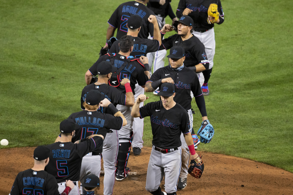 The Miami Marlins celebrate their Opening Day win against the Philadelphia Phillies at Citizens Bank Park on July 24, 2020 in Philadelphia, Pennsylvania.