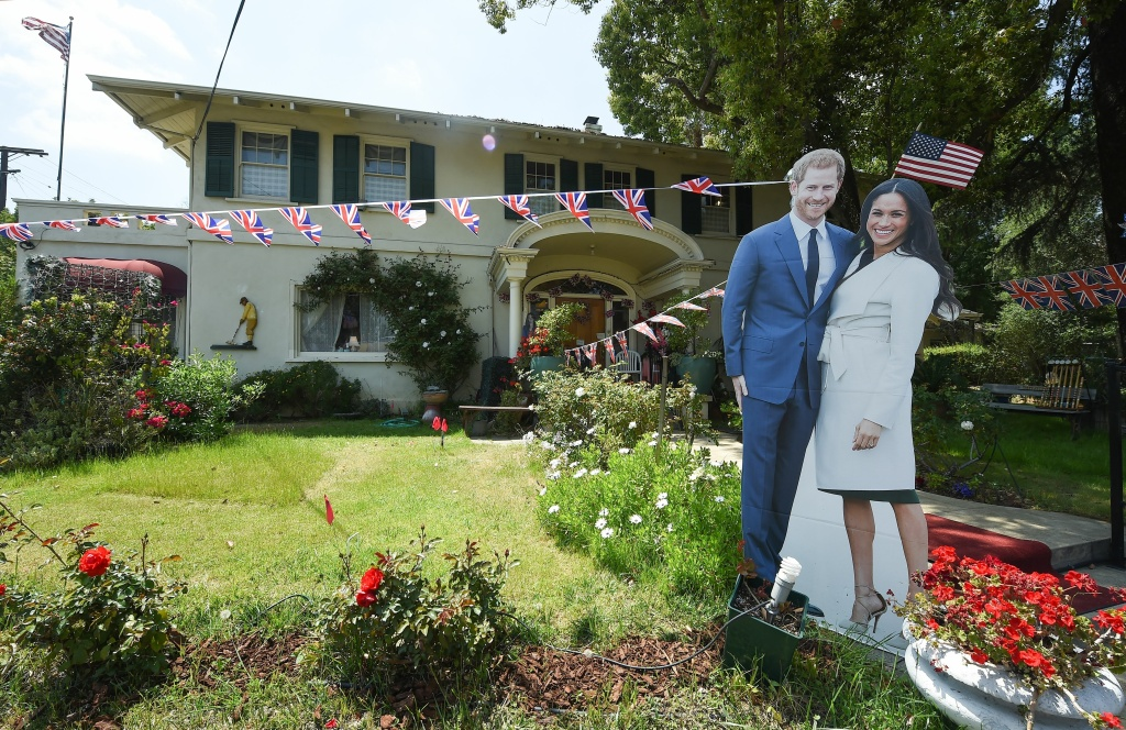 Cardboard cut outs of Prince Harry and Meghan Markle are seen at the entrance to The Rose Tree Cottage in Pasadena, where Meghan Markle has been a guest. The Rose Tree Cottage will celebrate the wedding of Prince Harry and Meghan Markle with a high tea on Saturday, May 19, 2018.