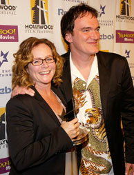 Editor Sally Menke with her Editing award poses with director Quentin Tarantino backstage at The Hollywood Awards Gala at the Beverly Hilton Hotel October 18, 2004 in Beverly Hills, California.