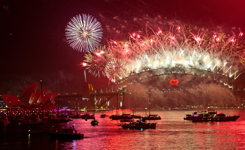 Spectator boats in Sydney Harbour look on as New Year's Eve fireworks erupt over the Sydney Harbour Bridge on January 1, 2013. Sydney kicked off a wave of dazzling firework displays welcoming in 2013, from Dubai to Moscow and London, with long-isolated Yangon joining the global pyrotechnics for the first time.