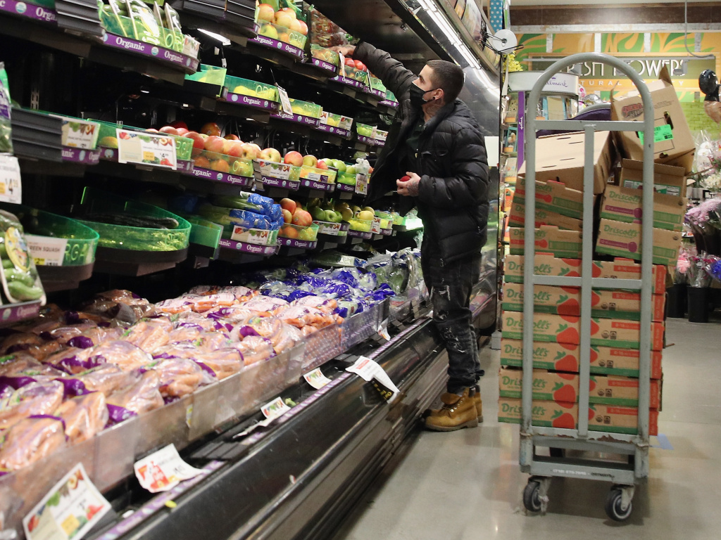 Workers at a ShopRite supermarket stock shelves on April 24, 2020 in Plainview, New York. Consumer prices jumped in March, marking a return of inflation, but the Federal Reserve insists any uptick will be temporary.