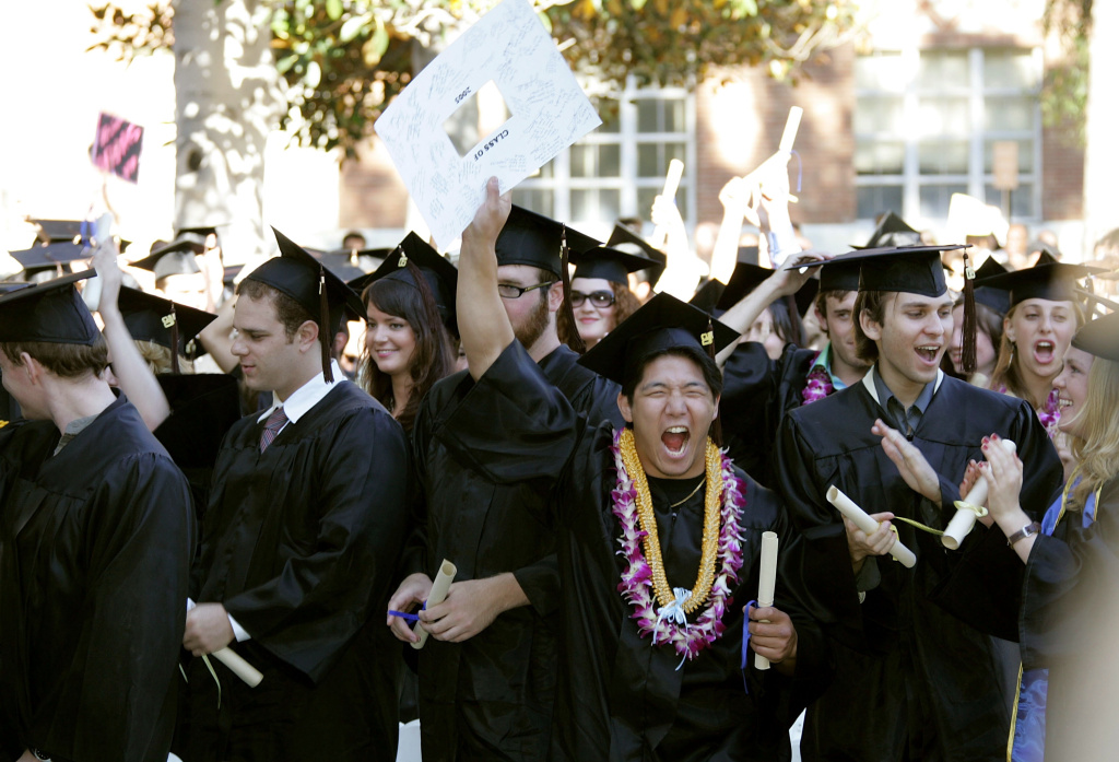 Students celebrate at the commencement ceremony at UCLA's School of Theater, Film and Television on June 17, 2005 in Los Angeles, California.