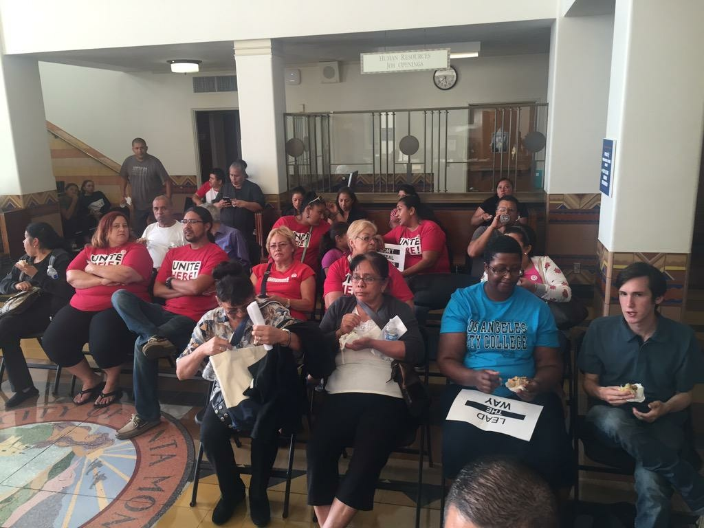 Labor activists wait in the lobby as the Santa Monica City Council meets in closed session Tuesday, Sept. 29, 2015.