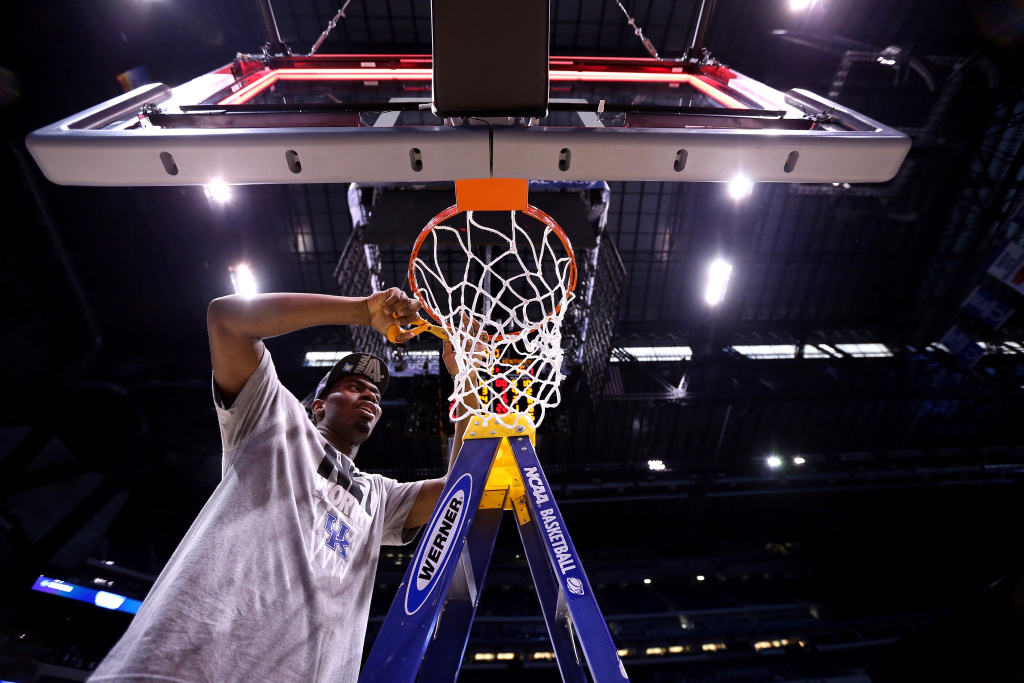 Alex Poythress #22 of the Kentucky Wildcats cuts the net after defeating the Michigan Wolverines 75 to 72 in the midwest regional final of the 2014 NCAA Men's Basketball Tournament at Lucas Oil Stadium on March 30, 2014 in Indianapolis, Indiana.