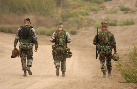 Memebrs of G Company, 2ed Battalion, Fourth Marine Division walk down a road during a break from combat readiness training October 3, 2001 at Camp Pendleton, CA.