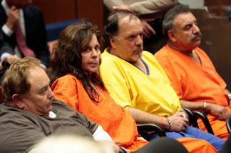 File photo: Former and current Bell city employees attend a bail reduction hearing in Superior Court September 22, 2010 in Los Angeles, California. Pictured are (L-R) former city Manager Robert Rizzo, former assistant City Manager Angela Spaccia, former city Councilman Victor Bello and Mayor Oscar Hernandez.