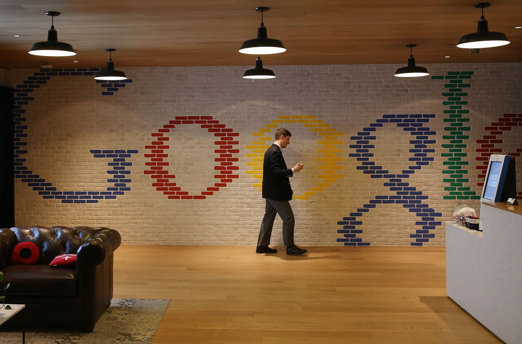An employee walks through the lobby of Google's Washington headquarters, January 8, 2015 in Washington, DC.
