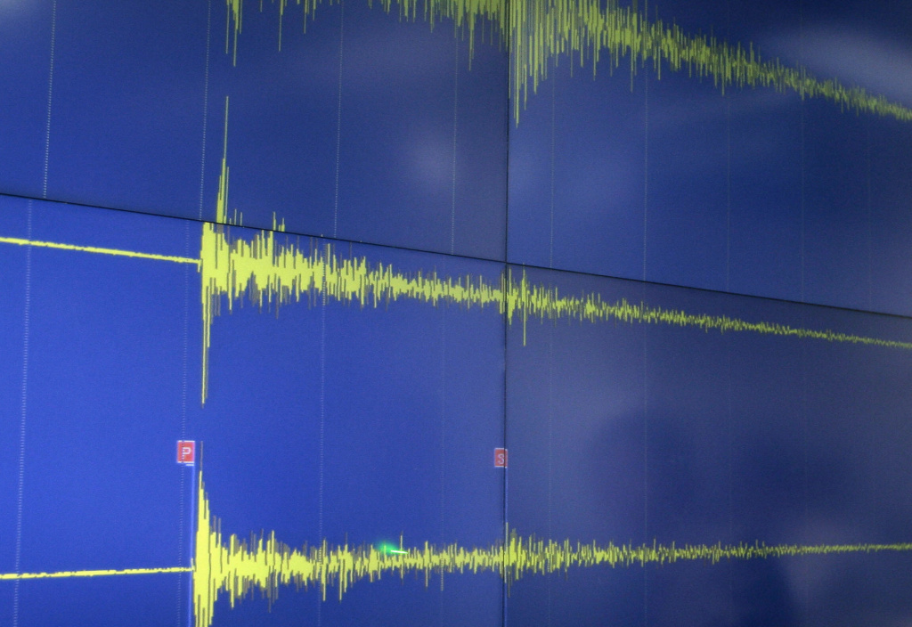 An earthquake triggers a reading on a seismic wave detector.