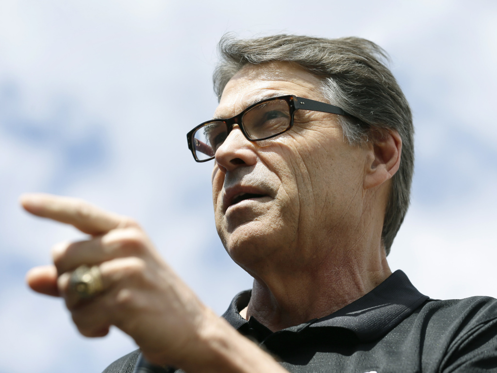 Texas Gov. Rick Perry speaks at the <em>Des Moines Register</em>'s Political Soapbox at the Iowa State Fair on Tuesday. Late Friday, Perry was indicted on abuse-of-power charges.