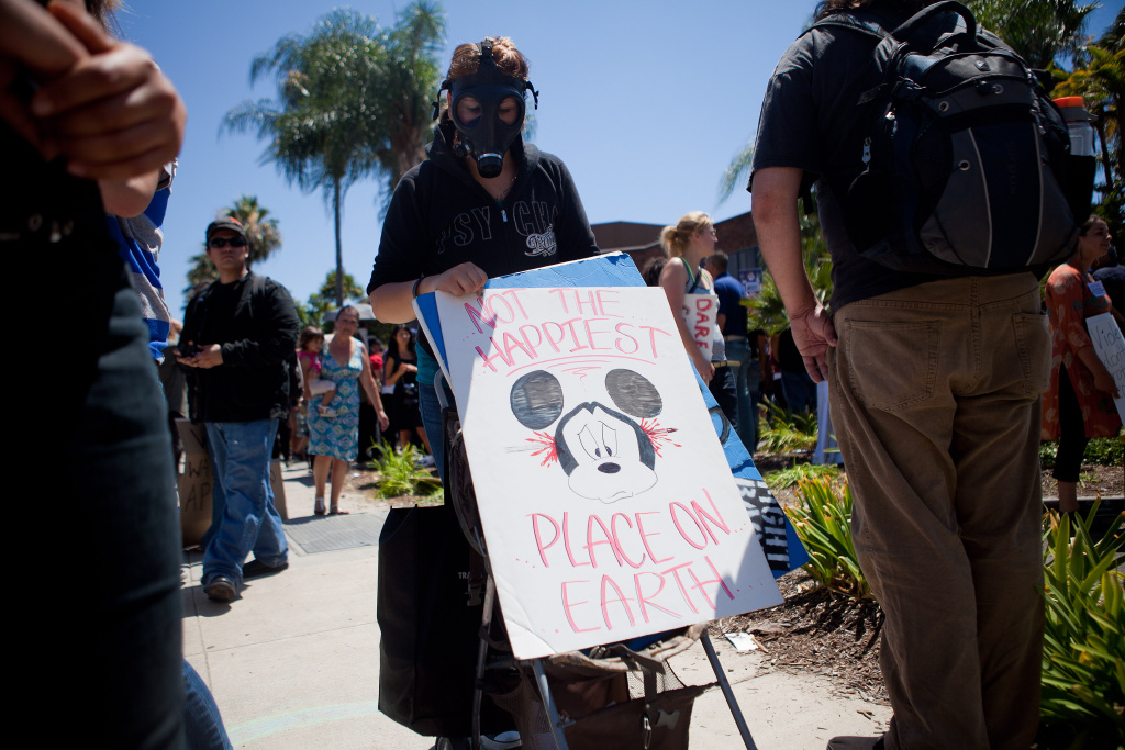 ANAHEIM, CA - JULY 29: Protesters march past the Orange County Police Department  during a demonstration to show outrage for the several recent office involved shootings on July 29, 2012 in Anaheim, California. For the past week, protesters have clashed with police resulting in both property damage and many arrests. (Photo by Jonathan Gibby/Getty Images)
