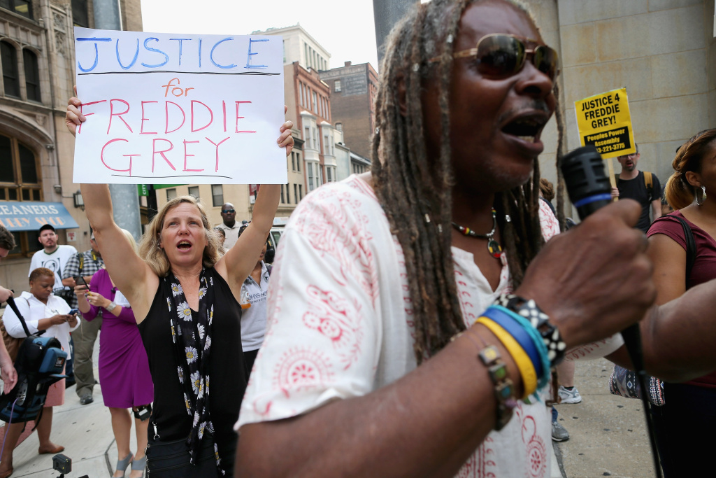A small group of demonstrators gather to protest in front of the Baltimore City Circuit Courthouse East where pre-trial hearings were held for six police officers charged in the death of Freddie Gray September 2, 2015 in Baltimore, Maryland.