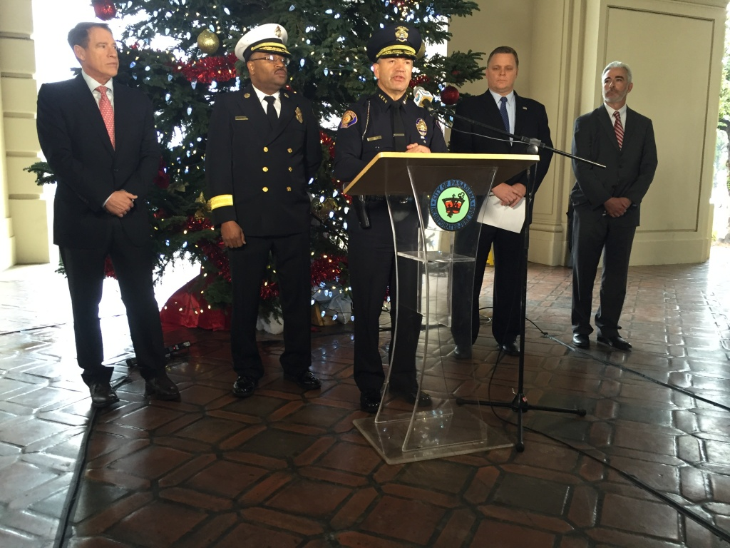 Pasadena Police Chief Phillip Sanchez speaks with reporters at City Hall about security preparations for the 2016 Rose Parade and Rose Bowl. He is joined by Fire Chief Bertral Washington (L) and U.S. Department of Homeland Security Special Agent-In-Charge Mark Selby.