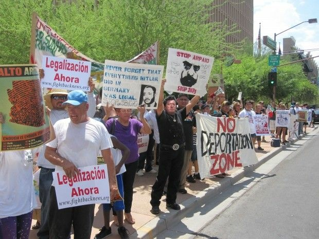 Protesters rally in Phoenix on July 29, 2010, the day SB 1070 was partly enacted with four provisions blocked.
