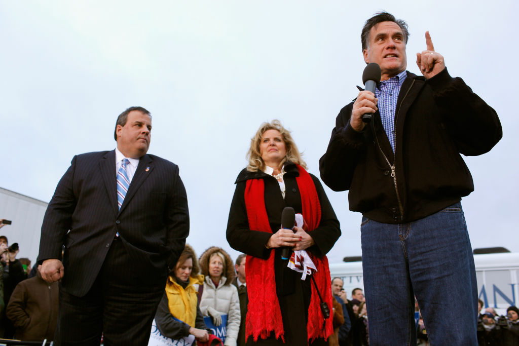 Former Massachusetts Governor and Republican presidential candidate Mitt Romney (R) addresses a campaign rally with his wife Ann Romney (C) and New Jersey Governor Chris Christie at a Hy Vee supermarket December 30, 2011 in West Des Moines, Iowa. Christie, a popular Republican governor who was urged to run for president earlier this year, appeared with Romney just days before the