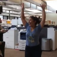 KPCC photog Maya Sugarman, gleeful in the newsroom when UCLA wins basketball game on questionable goaltending call.