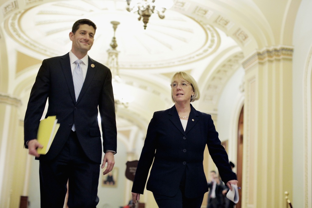 House Budget Committee Chairman Paul Ryan (R-WI) and Senate Budget Committee Chairman Patty Murray (D-WA) walk past the Senate chamber on their way to a press conference to announce a bipartisan budget deal, the Bipartisan Budget Act of 2013, at the U.S. Capitol on December 10, 2013 in Washington, DC.