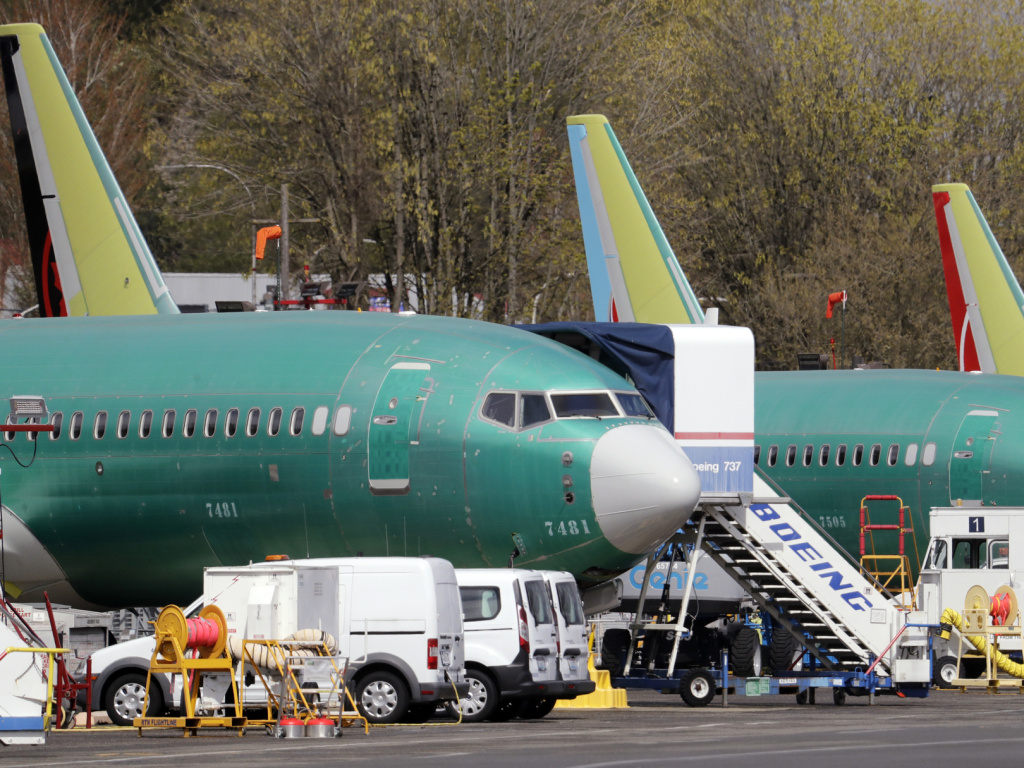 Boeing said on Sunday that it was aware of problems with a key safety indicator in 2017, but it didn't inform airlines or the FAA until after the Lion Air crash a year later. Here, 737 Max jets built for American Airlines, left, and Air Canada are parked at the airport adjacent to a Boeing production facility in Renton, Wash., in April.