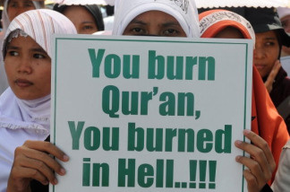 A group of Indonesian demonstrators belonging to the Hizbut Tahrir, an Islamists organization, rally outside the US embassy in Jakarta on September 4, 2010. The group threatened 'jihad' or holy war if a US Christian group goes through with threats to publicly burn the Koran. The US-based Dove World Outreach Center's planned Koran burning on the ninth anniversary of the September 11 terror attacks would unleash uncontrollable rage from Muslims around the world, a spokesman for the protesters warned.