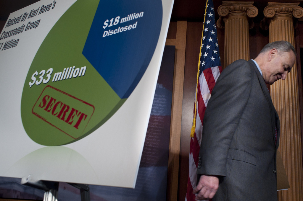 WASHINGTON, DC -  FEBRUARY 1:  U.S. Sen. Charles Schumer (D-NY) leaves following a news conference on Super PACs. with U.S. Sen. Sheldon Whitehouse (D-RI) and Al Franken (D-MN) on Capitol Hill February 1, 2012 in Washington, DC. Schumer commented on the amount of money 3rd party groups are spending on advertising during the Republican primary elections.  (Photo by Pete Marovich/Getty Images)
