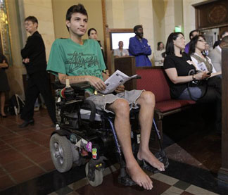 Michael Oliveri waits in his motorized wheelchair for his turn to speak on the regulation of marijuana for medical use in the city of Los Angeles, before the city council in council chambers at City Hall Wednesday, Nov. 18, 2009.